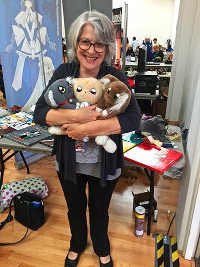 Petrea Burchard holding Ryo-ohki dolls (Photo - The Captain).